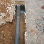 Unblock-A-Rod replaced the damaged pipes and repaired the tiling