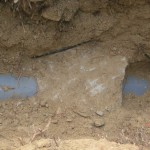An underground concrete slab had damaged the sewer pipe